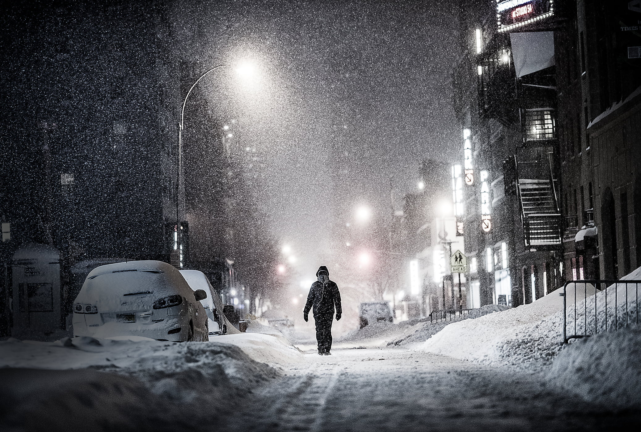 50 megapixels! A very high resolution VAST photo of a lonely person walking down an alley during the 2016 winter snow blizzard at night in New York City; created by Dan Piech