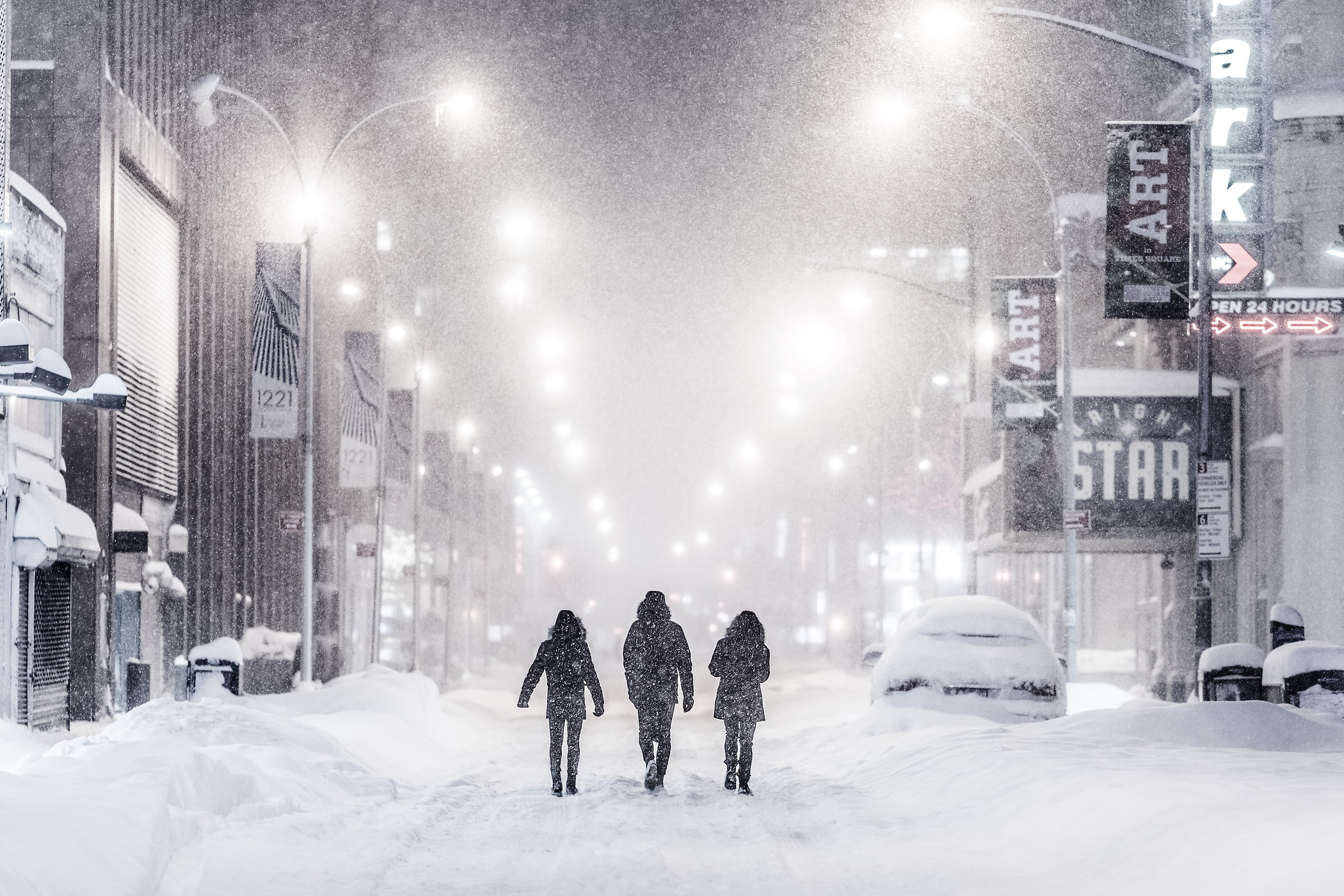 50 megapixels! A very high definition VAST photo of people walking down the street in Times Square during the 2016 winter snow blizzard at night in New York City; created by Dan Piech