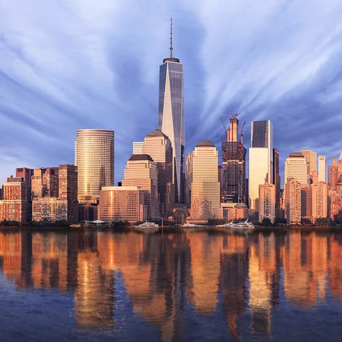 Thumbnail from A very high definition cityscape VAST photo of the Financial District, Battery Park City, and the World Trade Center reflecting in the Hudson River at sunset in New York City; created by Dan Piech