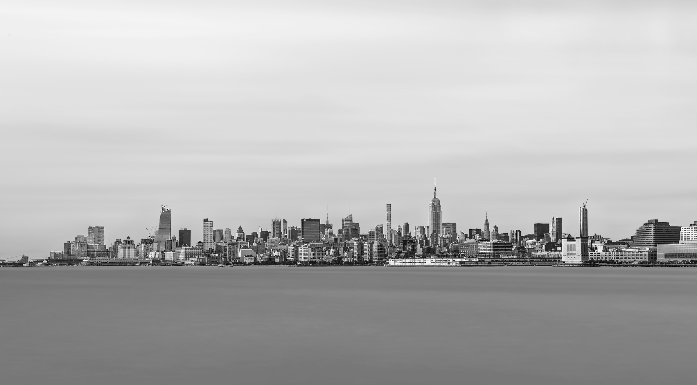 2,127 megapixels! A very high defintion long exposure cityscape VAST photo of the Midtown Manhattan New York City skyline and the Hudson River in black and white; created by Dan Piech