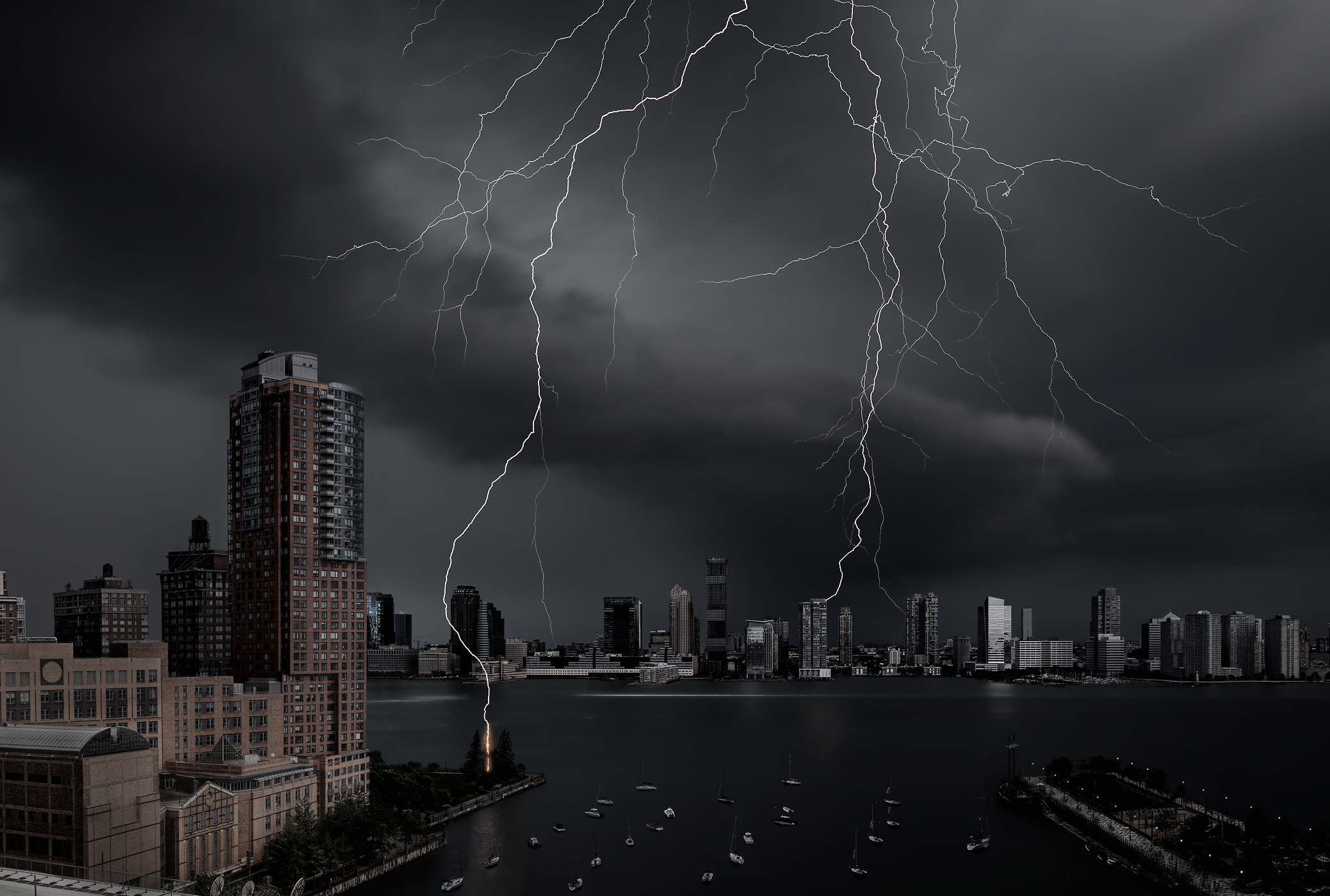 The highest definition VAST photo of a lightning bolt strike from a thunderstorm over the Hudson River and Tribeca Pointe in the Battery Park City neighborhood of New York City; created by Dan Piech