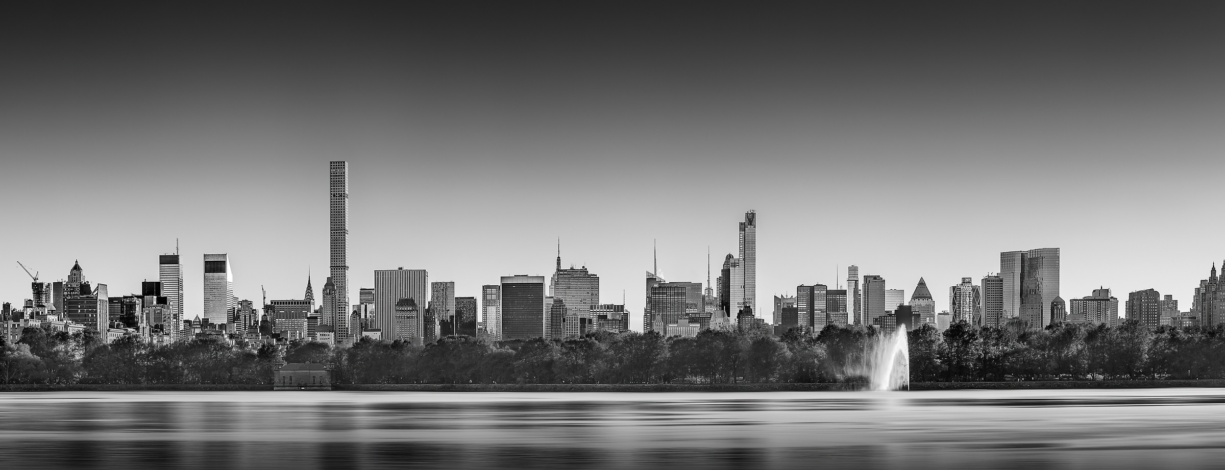 A very high definition cityscape VAST photo of the Midtown Manhattan city skyline in New York City from the reservoir in Central Park; created by Dan Piech