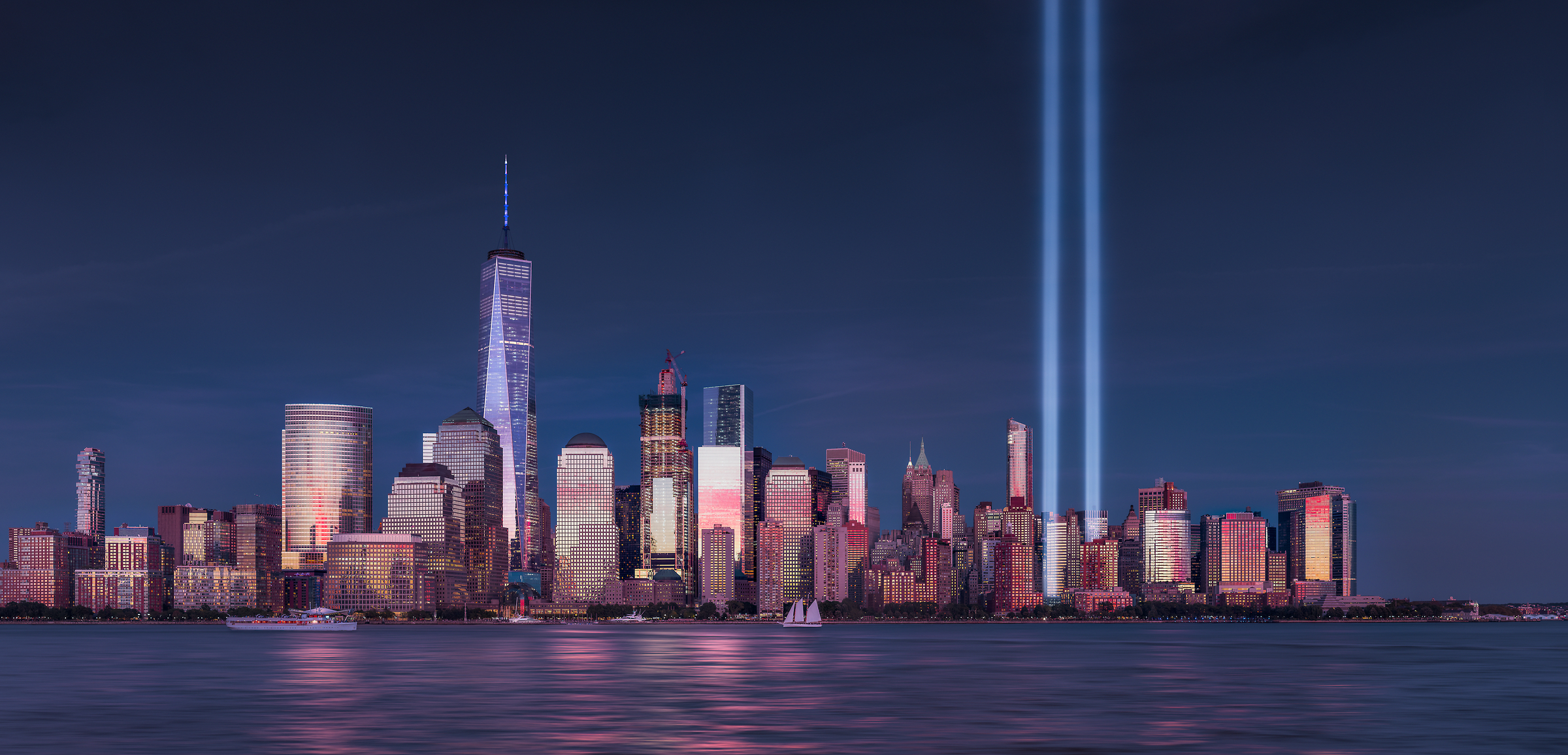 597 megapixels! The highest resolution VAST photo of the September 11th 9/11 Tribute in Light memorial, the World Trade Center, and the Manhattan city skyline at sunset in New York City; created by Dan Piech