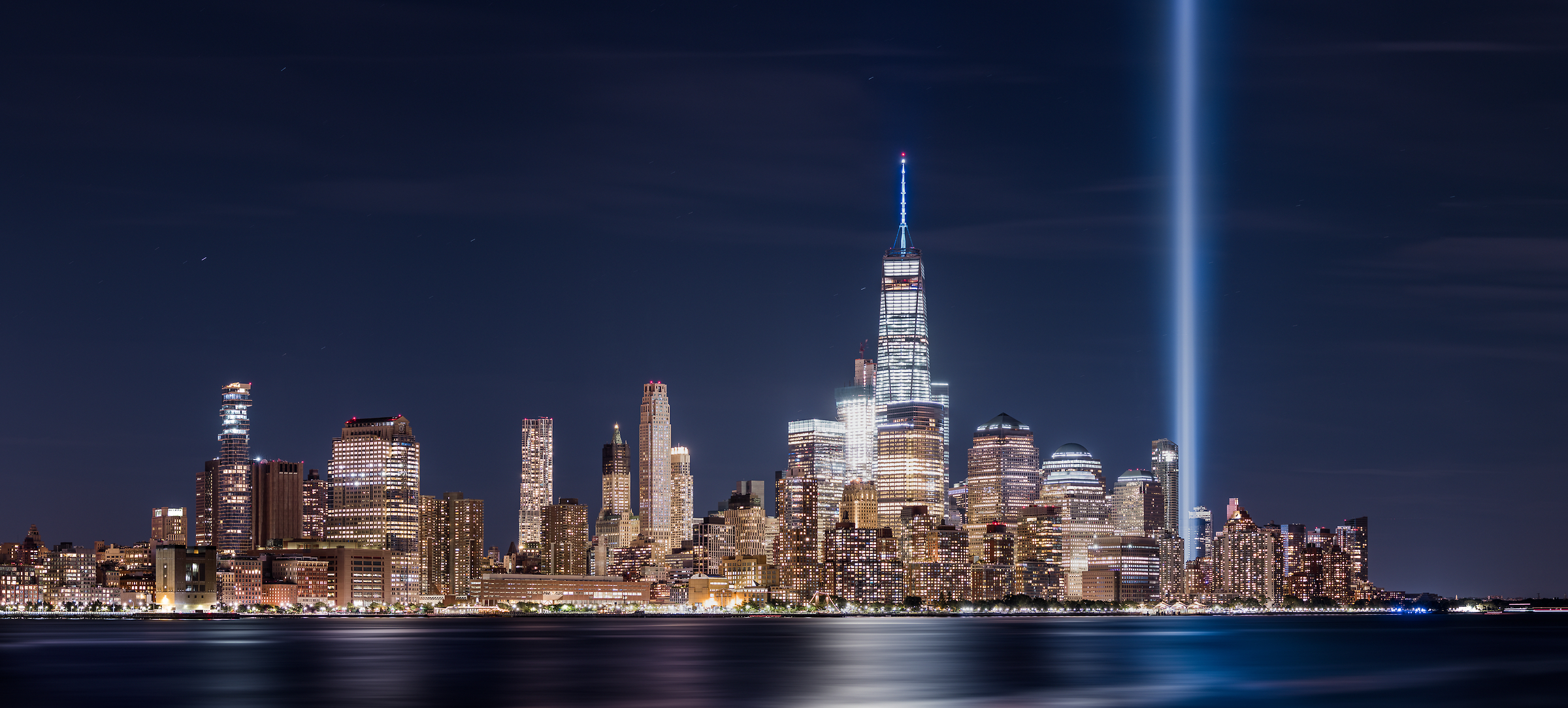 173 megapixels! A very high definition VAST photo of the September 11th 9/11 Tribute in Light memorial, the World Trade Center, and the Manhattan city skyline in New York City; created by Dan Piech