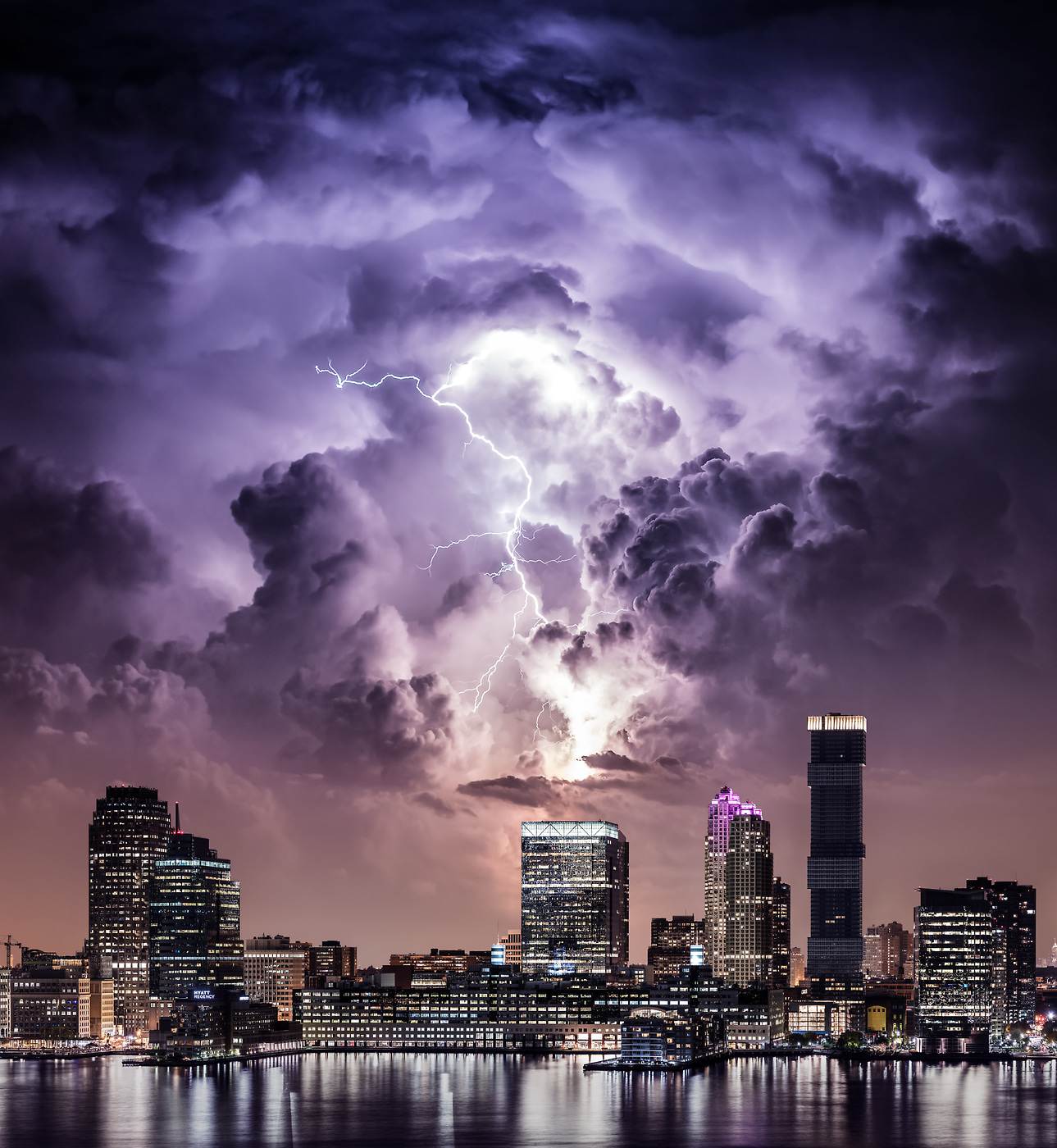 A very high resolution, large-format VAST photo print of a lightning bolt strike from a thunderstorm in Jersey City, NJ over URL Harborside 1; created by Dan Piech