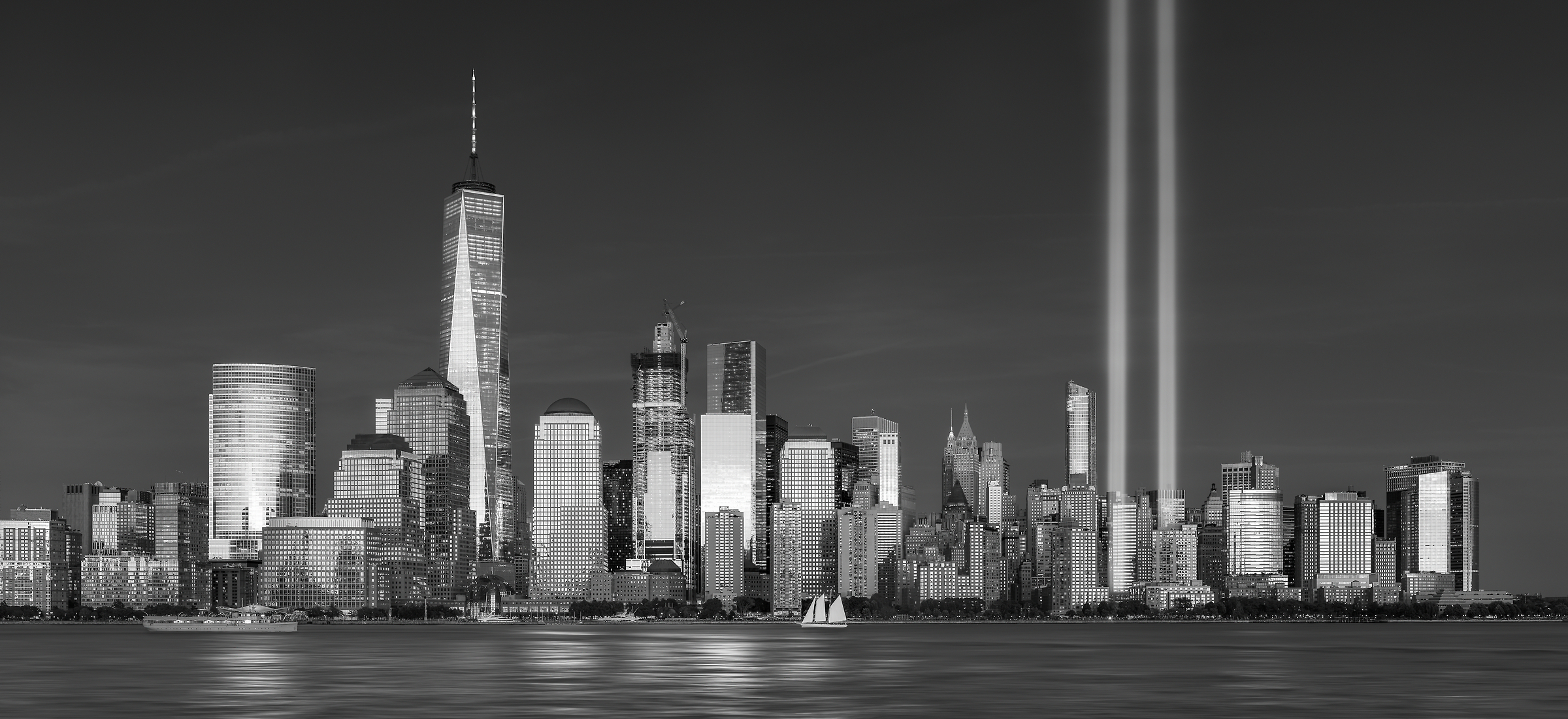 407 megapixels! The highest resolution VAST photo of the September 11th 9/11 Tribute in Light memorial, the World Trade Center, and the Manhattan city skyline at sunset in New York City; created by Dan Piech