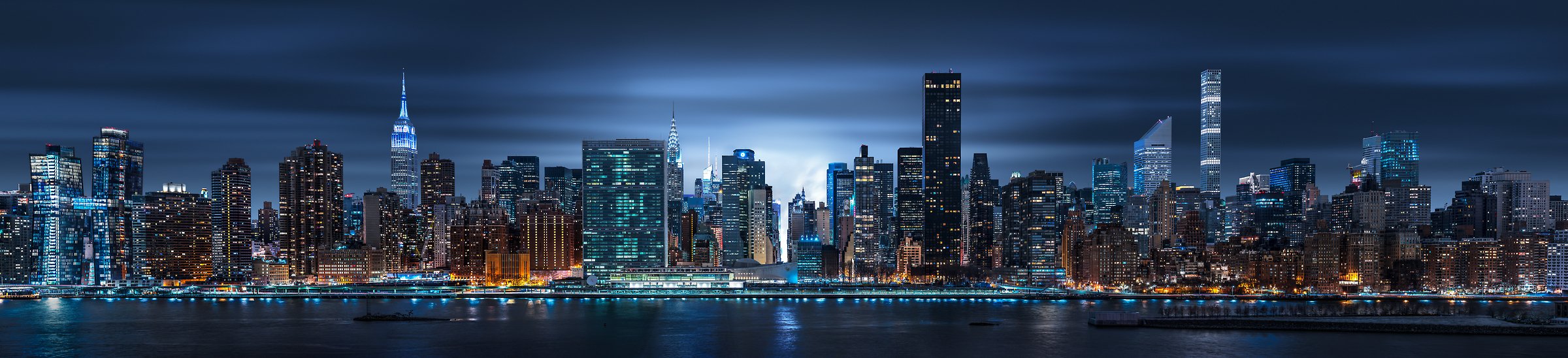 6,410 megapixels! A very high resolution, large-format VAST photo print of the NYC skyline at night with the East River; cityscape photo created by Dan Piech