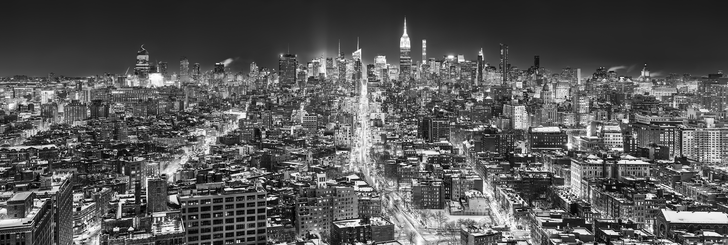 5,910 megapixels! A very high resolution, large-format VAST photo print of the Manhattan NYC skyline in winter snow at night; black and white cityscape fine art photo created by Dan Piech in New York City