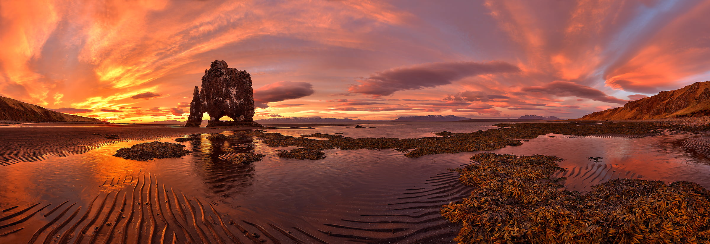 A very high resolution, large-format VAST photo of sunset and sunrise on the water with a giant rock structure called Hvítserkur Monolith or Dinosaur Rock; fine art landscape photo created by Scott Dimond in the Northwestern Region of Iceland