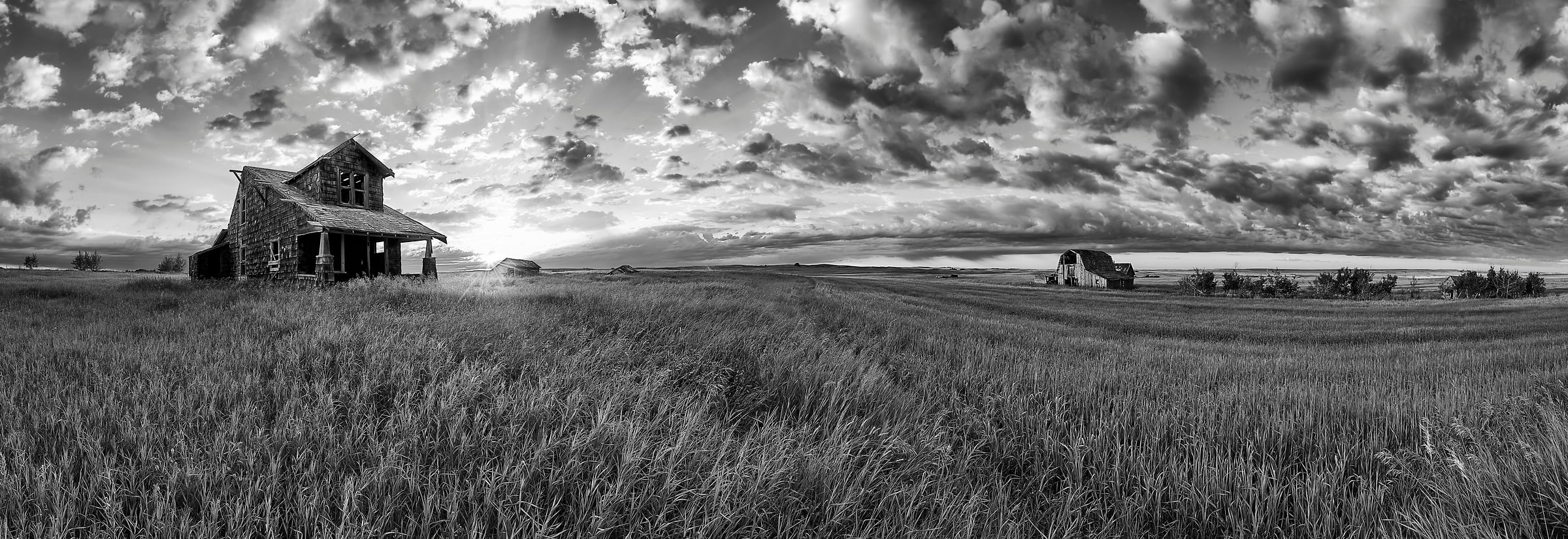 A very high resolution, large-format VAST photo of farmland, grasslands, the prairie, and an old abandoned house; fine art black and white landscape photo created at sunrise by Scott Dimond on the Great Plains in Alberta, Canada