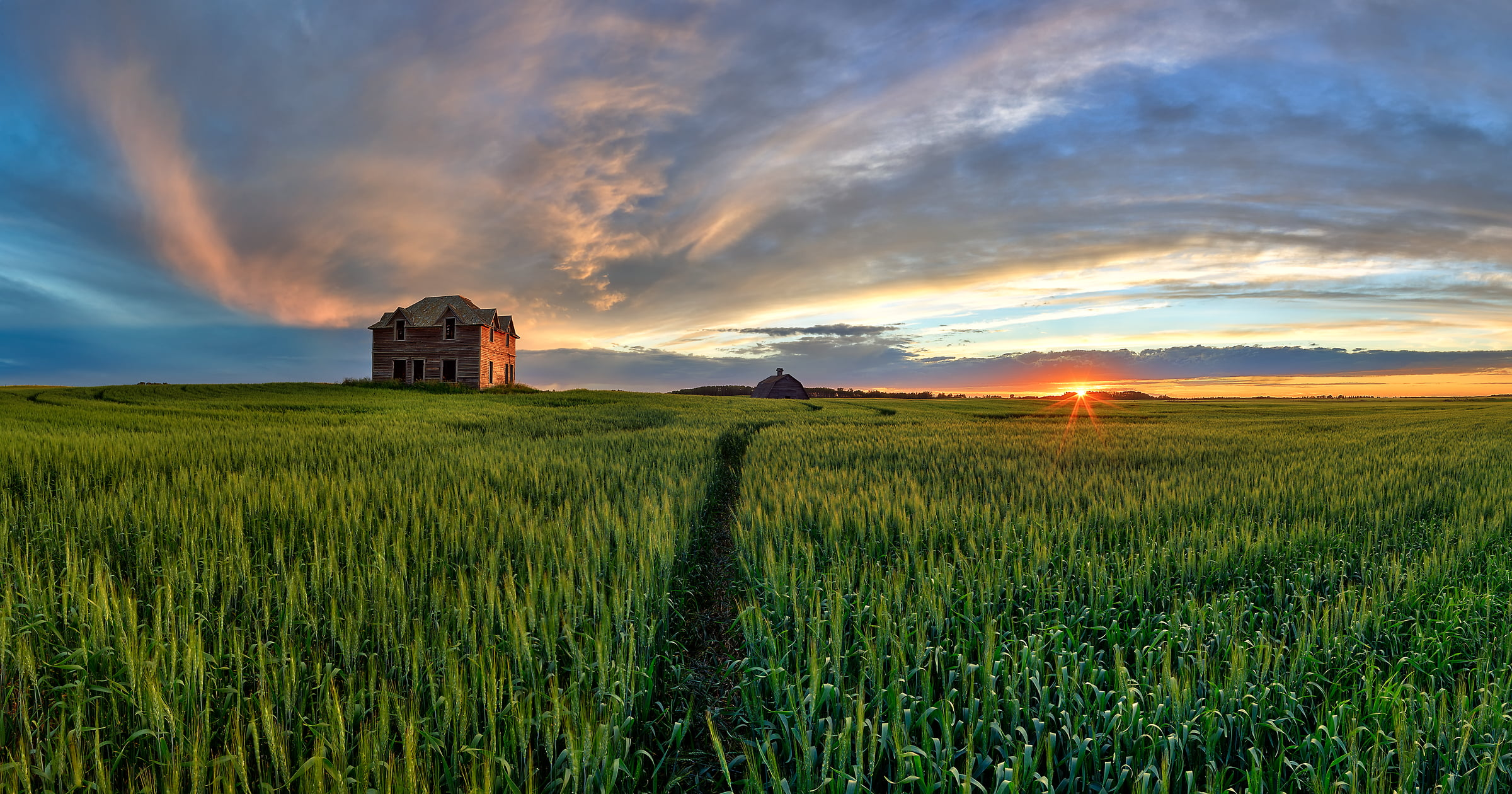 A very high resolution, large-format VAST photo of farmland, grasslands, the prairie, and an old abandoned house; fine art landscape photo created at sunset by Scott Dimond on the Great Plains in Alberta, Canada