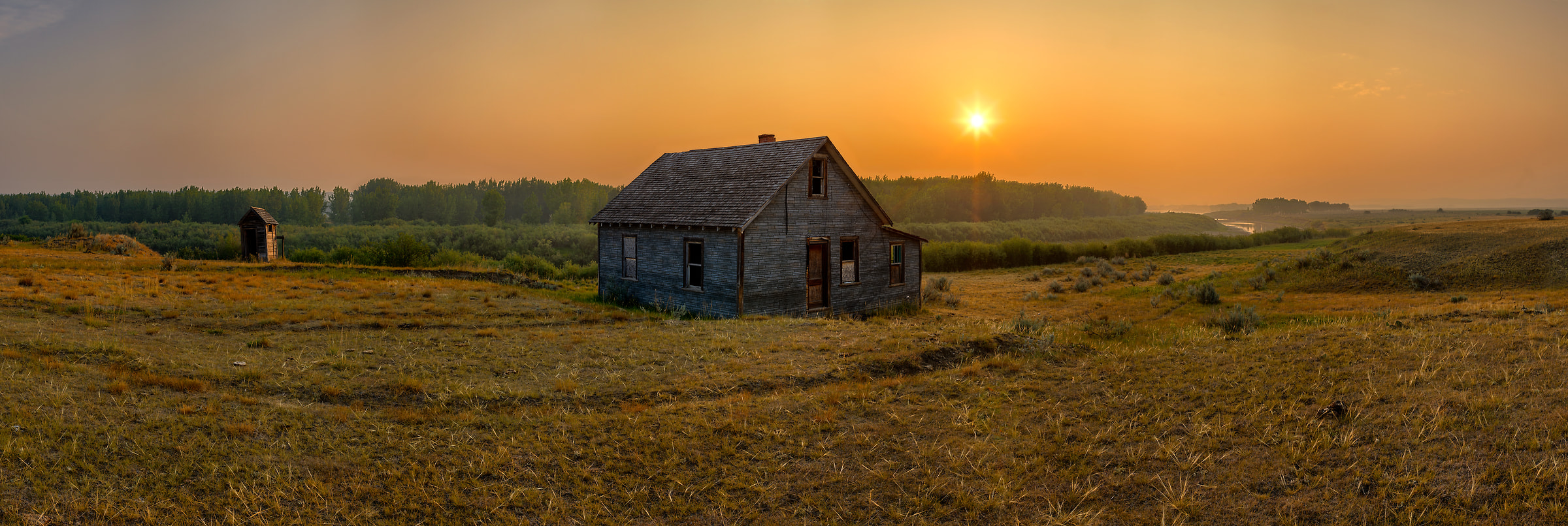 A very high resolution, large-format VAST photo of farmland, grasslands, the prairie, and an old abandoned house; fine art landscape photo created at sunrise by Scott Dimond on the Great Plains in Saskatchewan, Canada