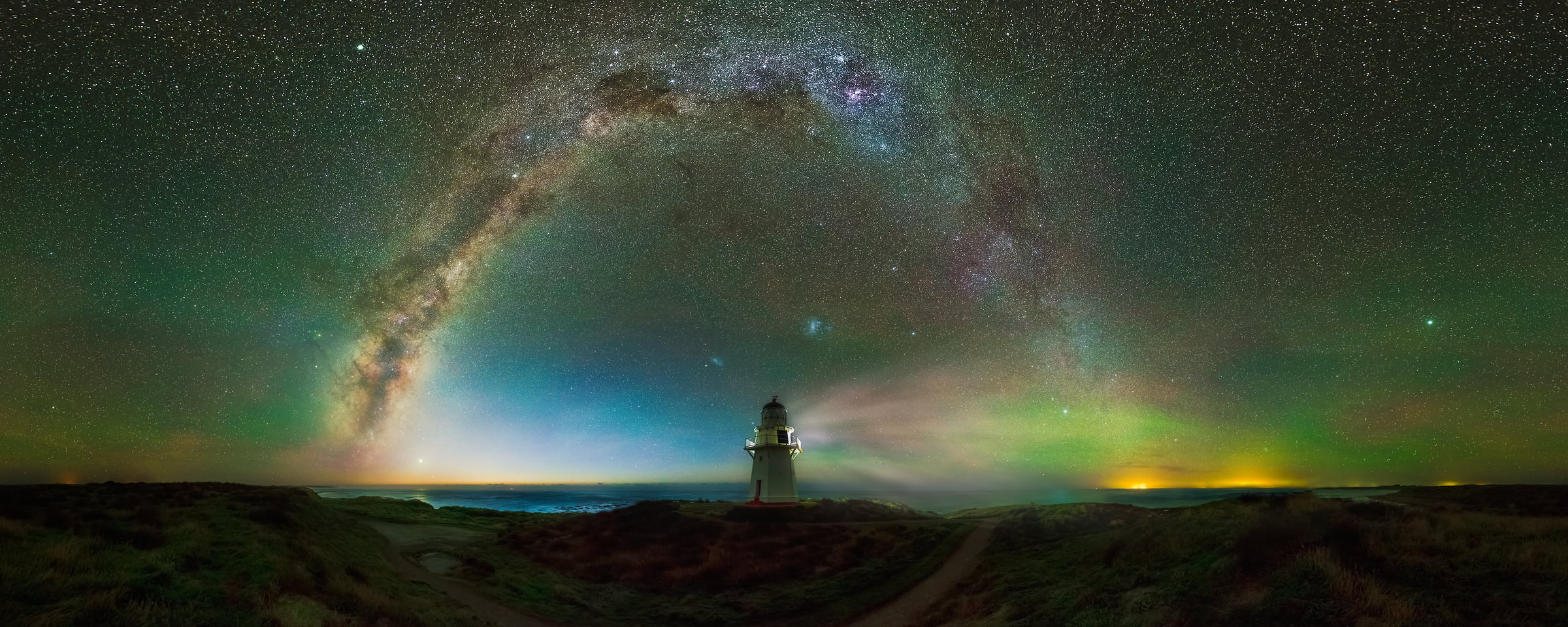 160 megapixels! A very high resolution, large-format VAST photo print of the night sky, milky way, and stars over a lighthouse; fine art astrophotography landscape photo created by Paul Wilson in Waipapa Point Lighthouse, Southland, New Zealand