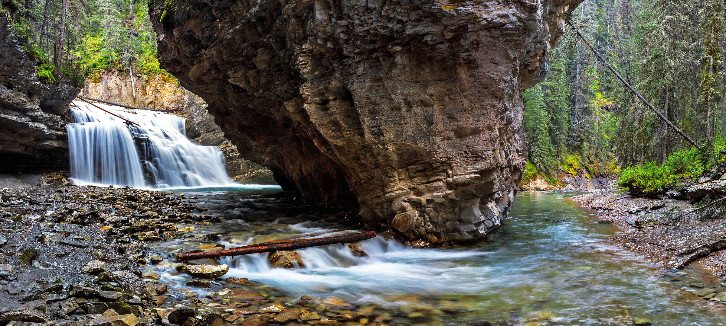 310 megapixels! A very high resolution, large-format VAST photo print of a waterfall, stream, rocks, and forest in the woods; fine art nature photo created by Chris Collacott in Banff National Park, Alberta, Canada
