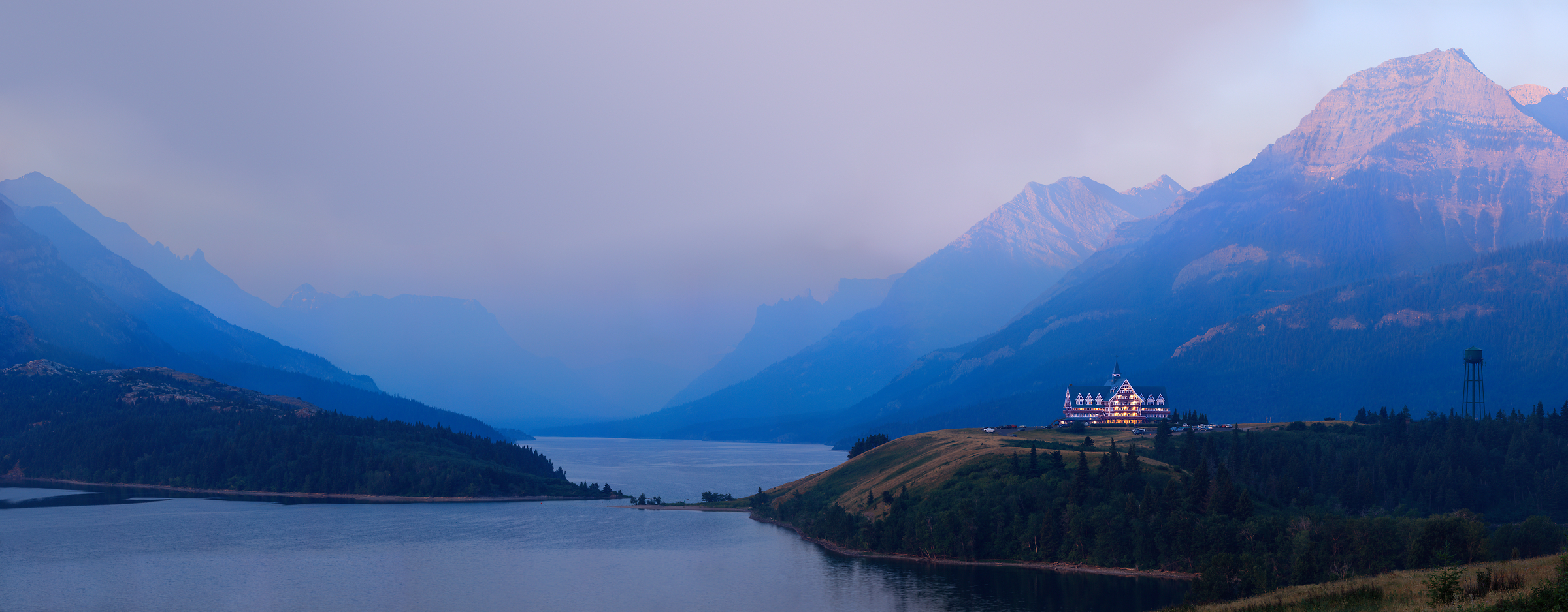 4,650 megapixels! A very high resolution, large-format VAST photo print of the Prince of Wales Hotel in Waterton Lakes National Park with smoke from a wildfire in the valley in the background; fine art landscape photograph created by Scott Dimond in Alberta, Canada