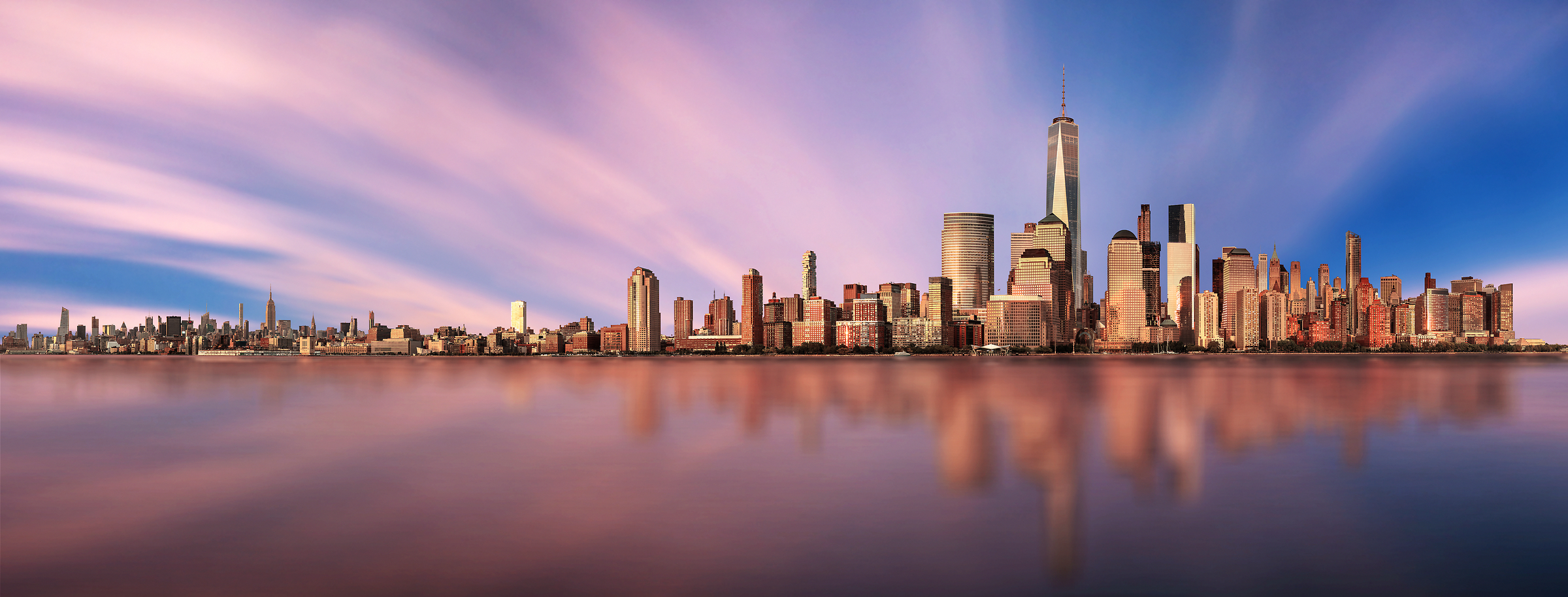 7,070 megapixels! An incredibly high resolution gigapanorama photo of sunset and the New York City skyline; cityscape fine art print created by Chris Collacott in Manhattan, NYC