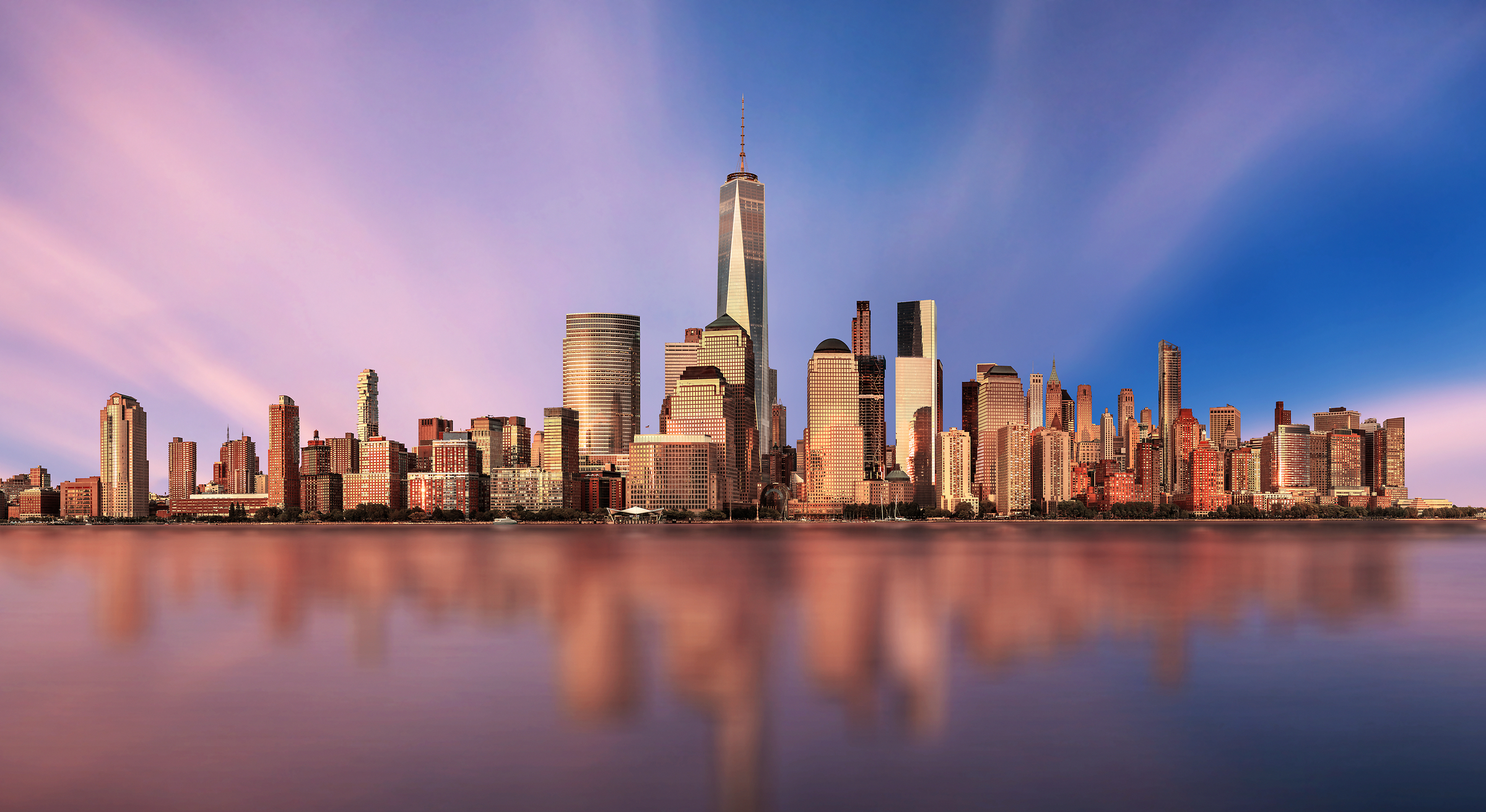 4,201 megapixels! An incredibly high resolution photo of a beautiful sunset, the NYC skyline, and the World Trade Center; cityscape fine art print created by Chris Collacott in Manhattan, New York City
