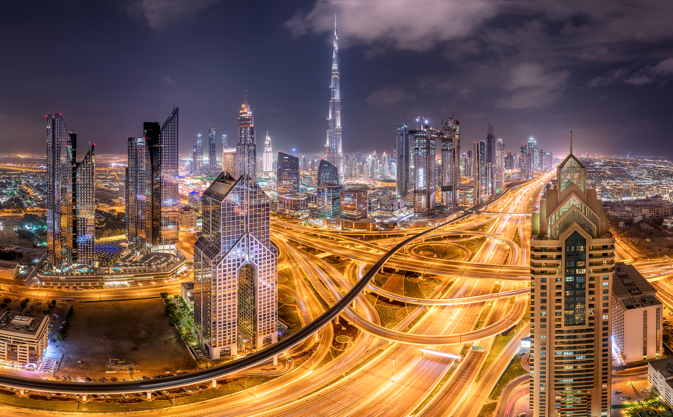 505 megapixels! A very high resolution, large-format VAST photo of the Dubai skyline and roads at night with the Burj Khalifa; fine art cityscape photograph created by Tim Shields in the United Arab Emirates