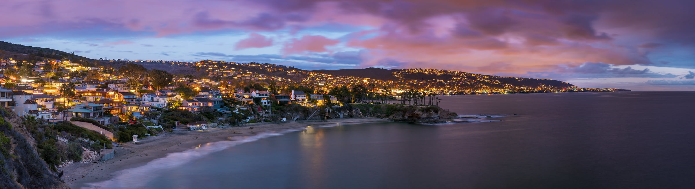 193 megapixels! A very high resolution, large-format VAST photo of a beach town at dusk with a sunset; panorama photograph created by Jim Tarpo in Laguna Beach, California
