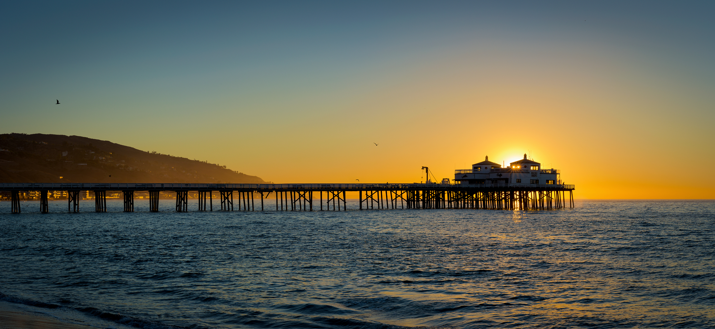 112 megapixels! A very high resolution, large-format VAST photo of the Malibu Pier at sunrise created by Jim Tarpo in Malibu, California