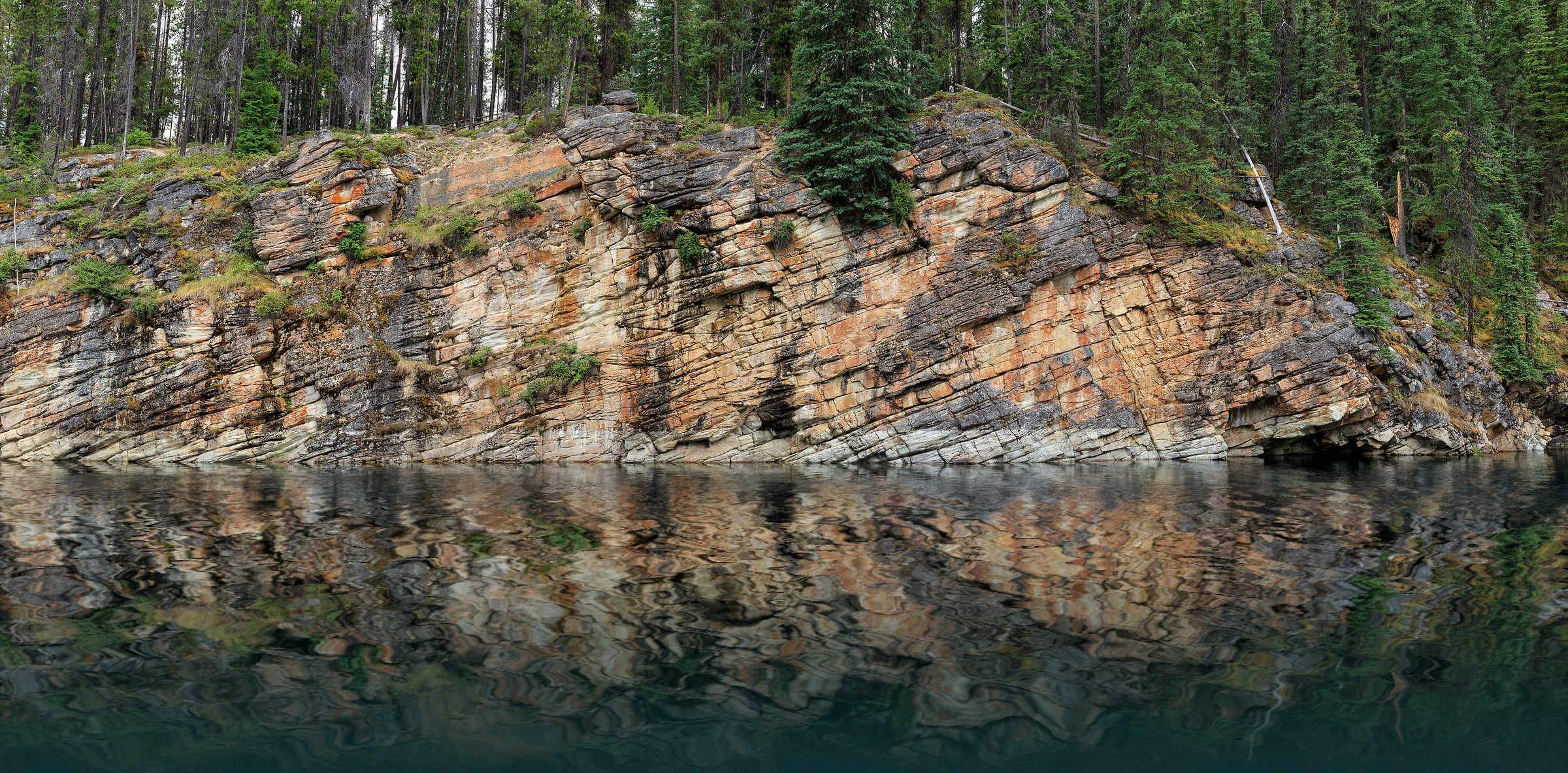 3,135 megapixels! A very high resolution, large-format photo of a rock wall, a calm lake, and an evergreen forest; nature photograph created by Scott Dimond at Horseshoe Lake in Jasper National Park, Alberta, Canada