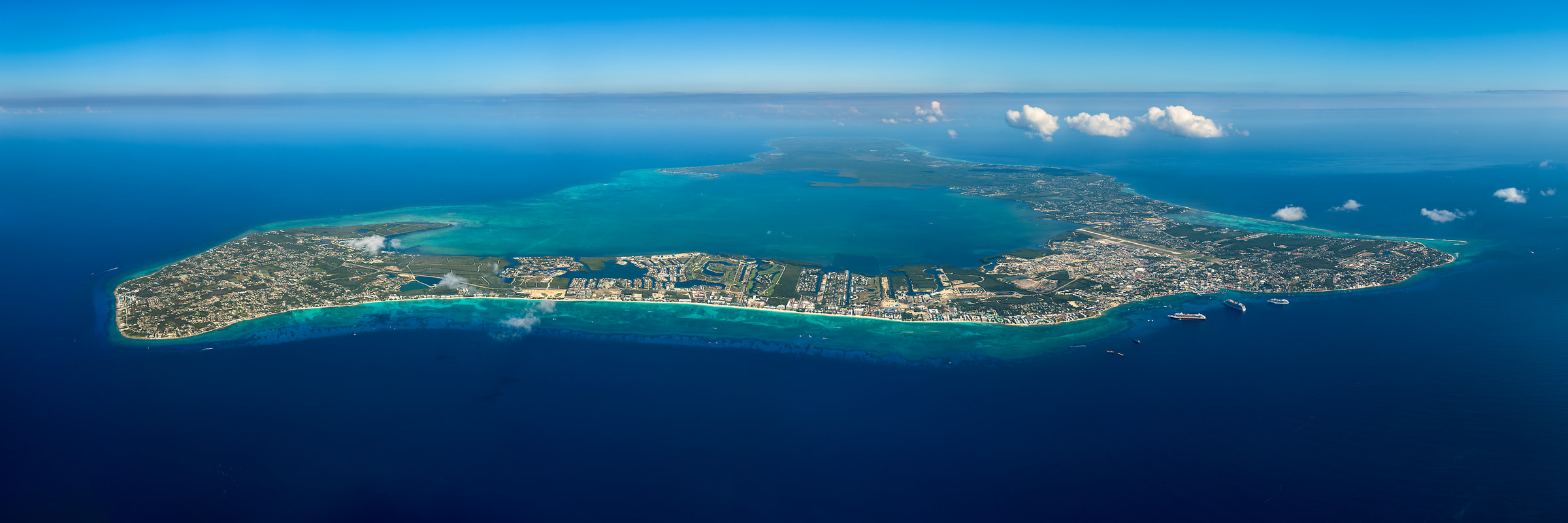 428 megapixels! A very high resolution aerial photo of Seven Mile Beach on Grand Cayman island; VAST photo created by Aaron Priest in the Cayman Islands