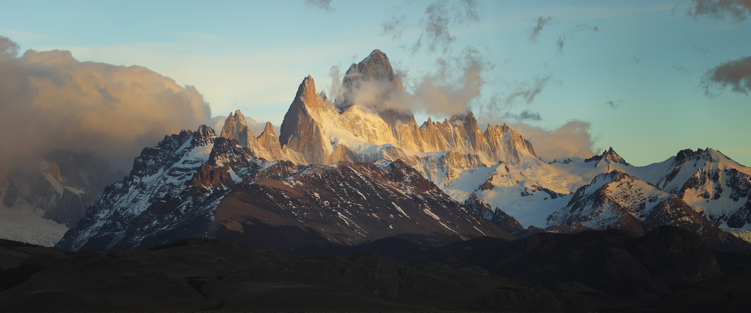 158 megapixels! A very high resolution, large-format VAST photo print of an epic mountain scene with clouds and blue sky above misty mountains; landscape photograph created by Alexandre Deschaumes in El chalten, Argentina, Patagonia