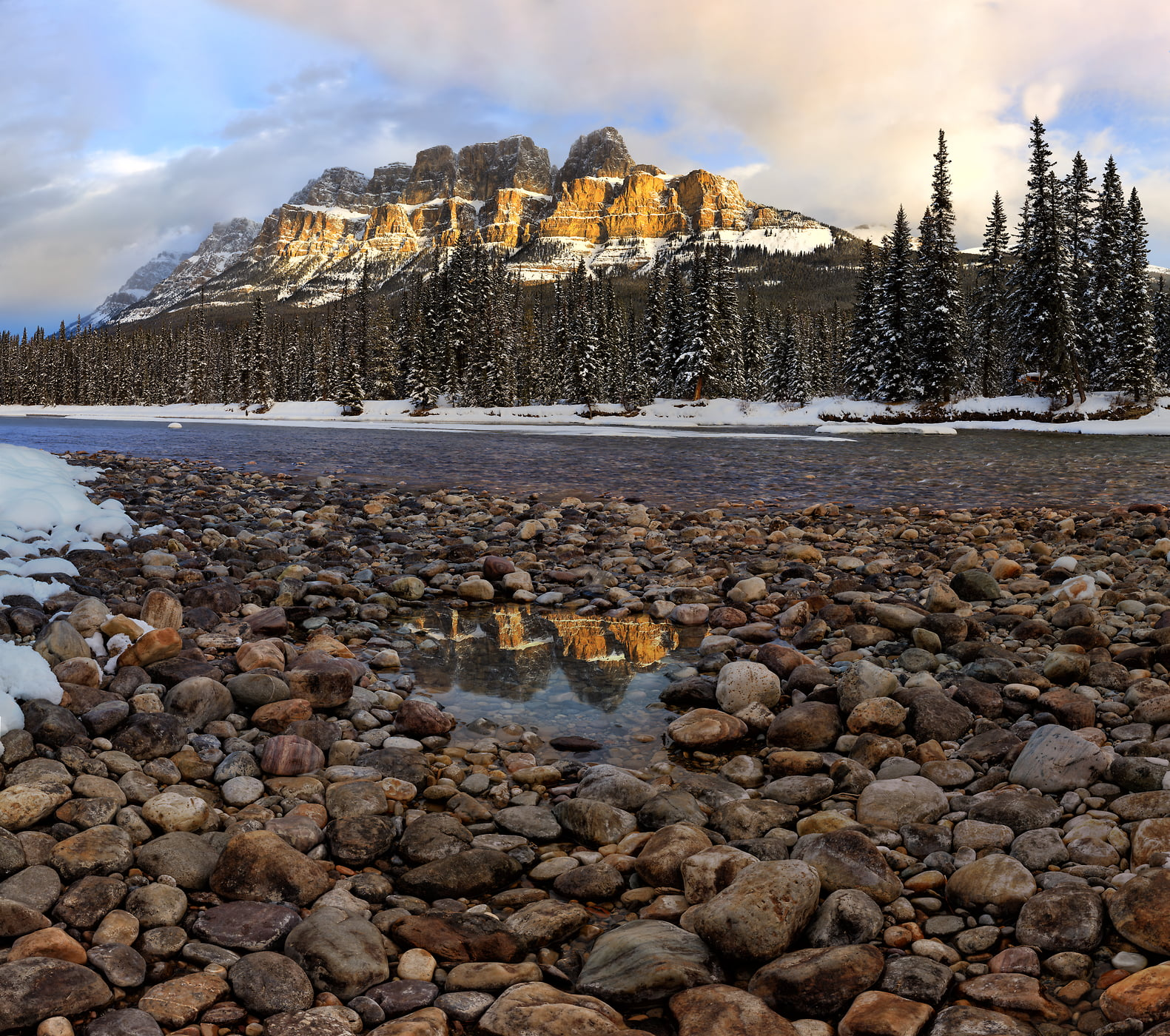 1,123 megapixels! A very high resolution, large-format VAST photo print of a stream with rocks on the side, backdropped by a snowy forest and large mountain range with Castle Mountain; landscape photograph created by Scott Dimond in Banff National Park, Alberta, Canada