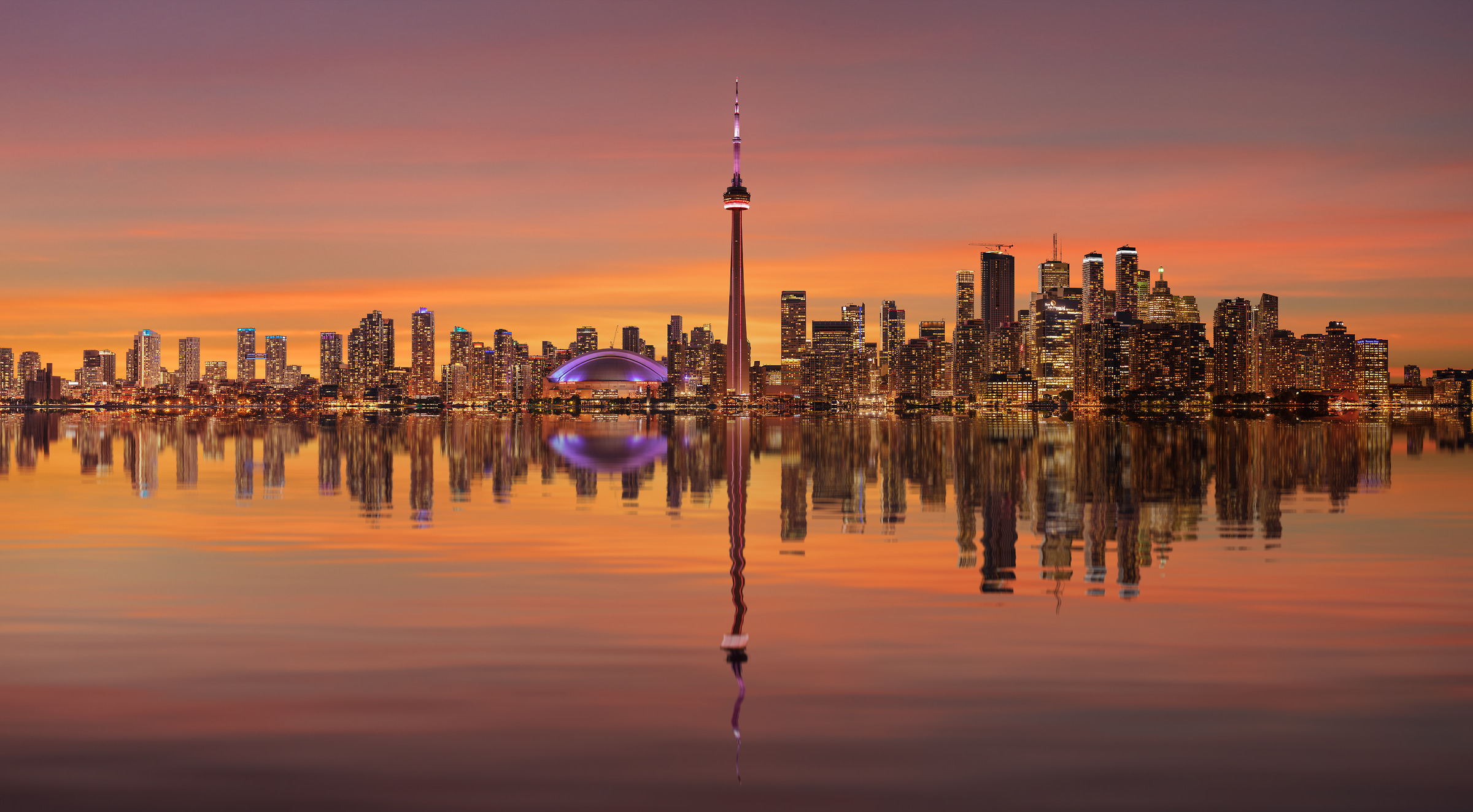 3204 megapixels! A very high resolution, large-format VAST photo print of the Toronto skyline at sunset with a reflection in Lake Ontario; cityscape photograph created by Chris Collacott in Toronto, Ontario, Canada.