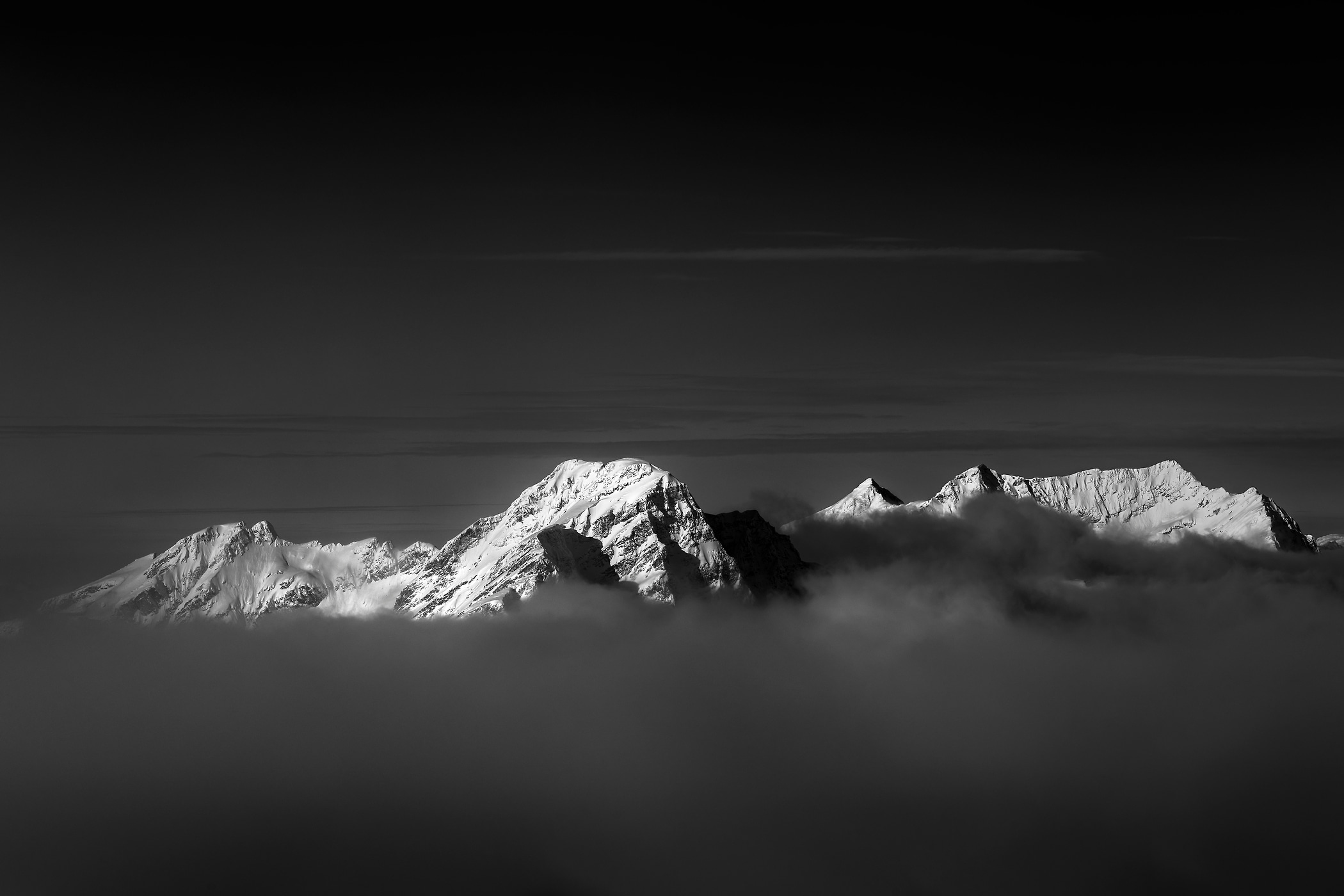 101 megapixels! A very high resolution, large-format VAST photo print of a mountain above the clouds; black and white landscape photograph created by Scott Rinckenberger in Davis Peak, Columbia Mountains, British Columbia, Canada