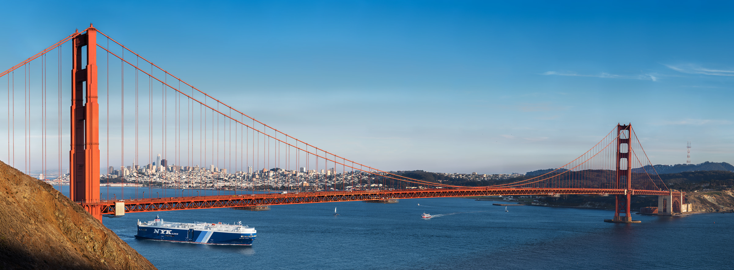 698 megapixels! A very high resolution, large-format VAST photo print of the Golden Gate Bridge in front of the San Francisco skyline on a blue sky day; photograph created by Jim Tarpo in Mill Valley, California