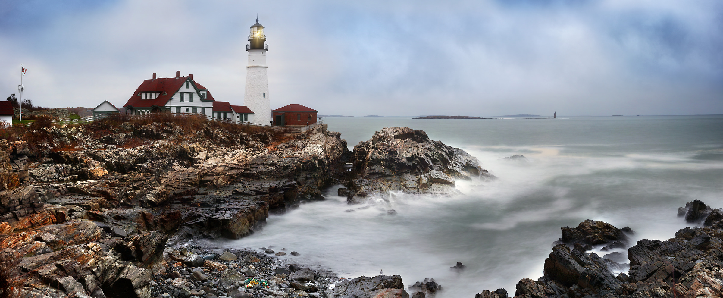 521 megapixels! A very high resolution, large-format VAST photo print of a lighthouse with the ocean and rocks; photograph created by Phil Crawshay in Portland Head Lighthouse, Portland, Maine