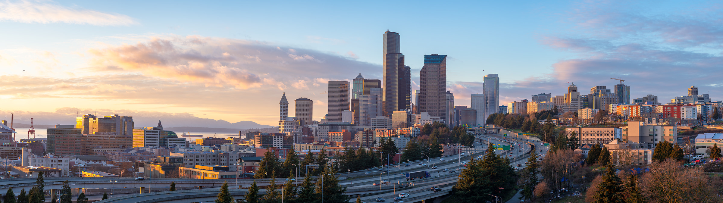 206 megapixels! A very high resolution, large-format VAST photo print of the Seattle, Washington skyline at sunset with highways in the foreground; cityscape photograph created by Greg Probst in Seattle, Washington
