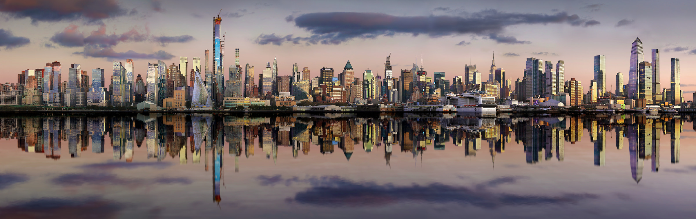 922 megapixels! A very high resolution, large-format VAST photo print of the New York skyline at sunset reflecting in the Hudson River; panorama photograph created by Phil Crawshay in New York, Manhattan
