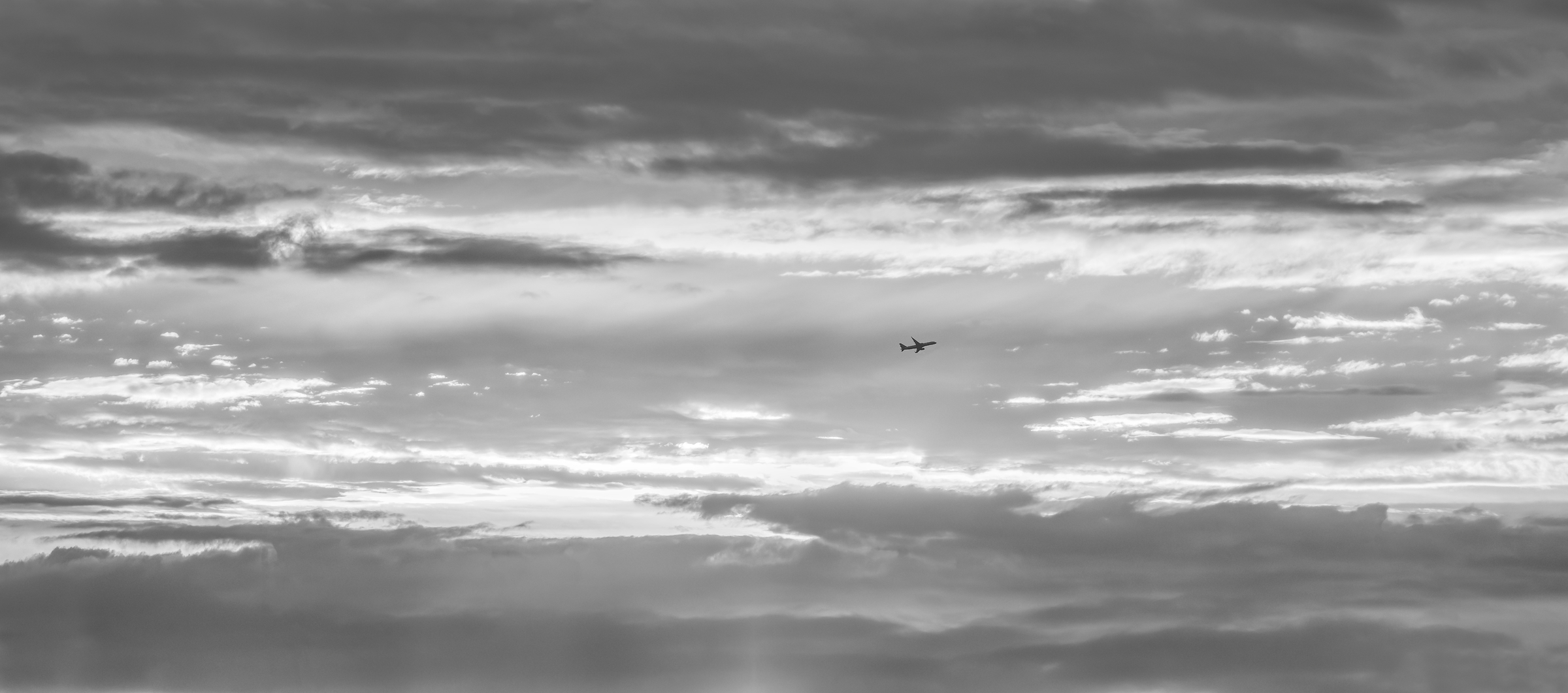 328 megapixels! A very high resolution, black & white VAST photo print of a plane with a sunset behind it; fine art photograph created by Dan Piech in New York City